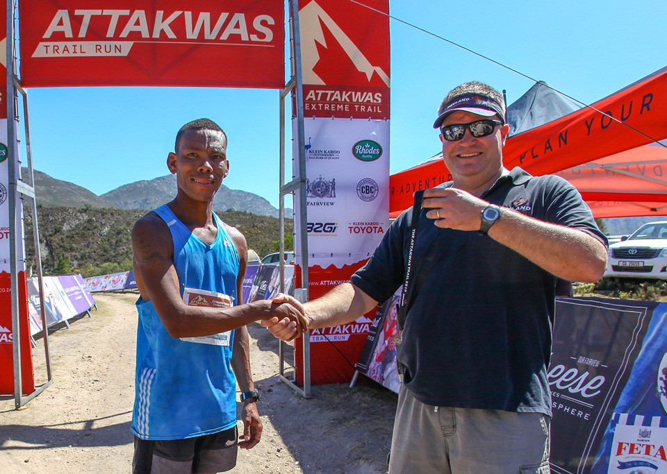 Ettienne Plaatjies poses with Dryland Event Management's Carel Herholdt after winning the 2016 Fairview Attakwas Trail on the 17th of December 2016