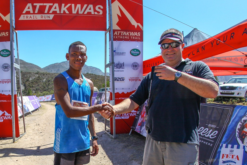 Ettiene Plaatjies, the winner of the first two editions of the Attakwas Trail, poses with Dryland Event Management's Carel Herholdt after winning the 2016 race. Photo by Oakpics.com.