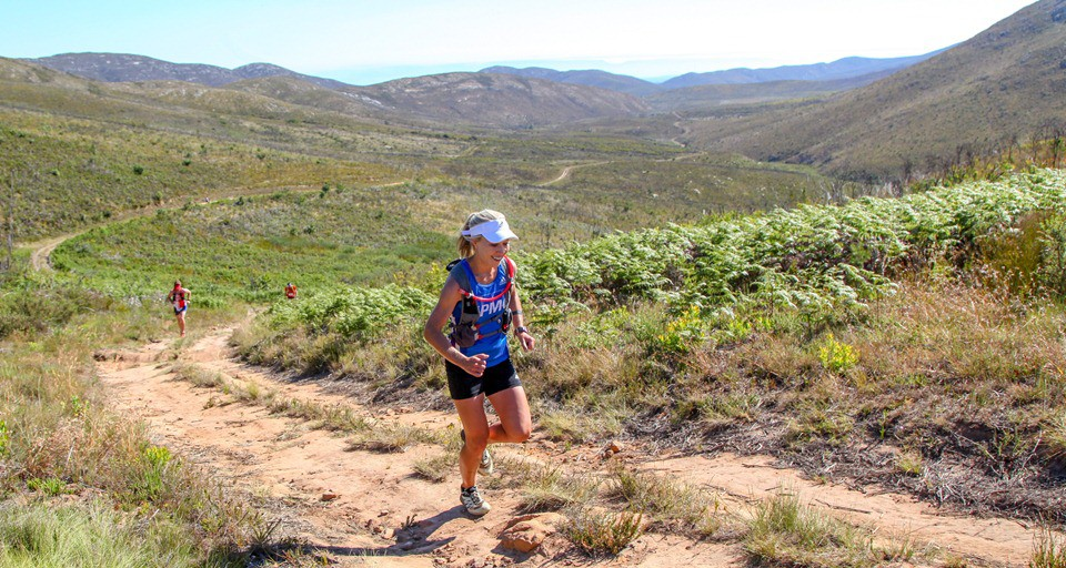 Danette Smith powering up the climb to the Attakwaskloof Neck on her way to victory in the women's race at the 2016 Fairview Attakwas Trail. Photo by Oakpics.com